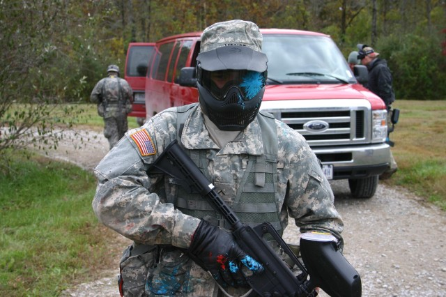 """Pvt. Michael Vance takes a paintball round to the face during a confrontation with a non-compliant """"host national"""" driver.  Vance attends the Patriot Academy, a National Guard initiative to give high-school dropouts a second chance to receive their high school diploma, become more proficient Soldiers and give back to the community."""