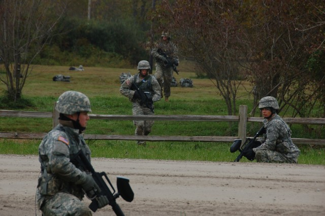 Students from the Patriot Academy at Muscatatuck Urban Training Center execute near-and-far security so fellow students can cross the road safely during a training exercise at Camp Atterbury Joint Maneuver Training Center, Oct. 16, 2009. The students at the Patriot Academy participate in military training while studying for their high school diploma.