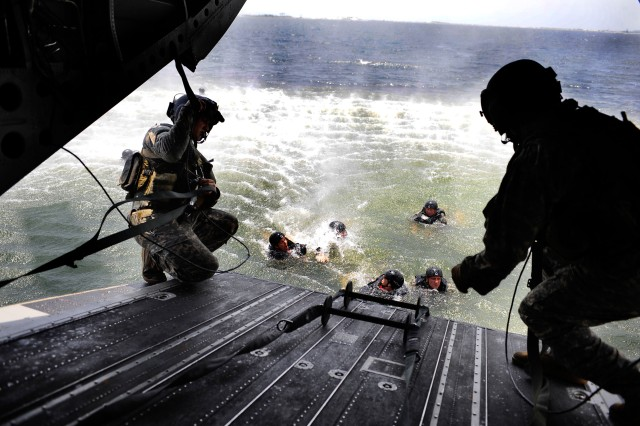 Aviators from the 160th Special Operations Aviation Regiment lower a rope ladder to other Soldiers so they can board their MH-47 Chinook during helo-cast training in the Gulf of Mexico, Aug. 5.