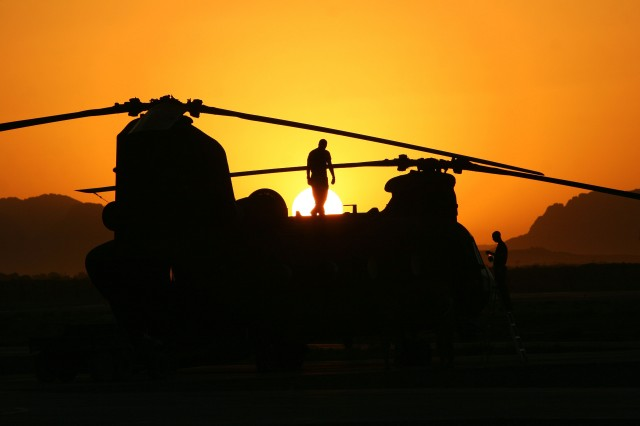 Soldiers perform maintenance on an MH-47 Chinook of the 160th Special Operations Aviation Regiment.