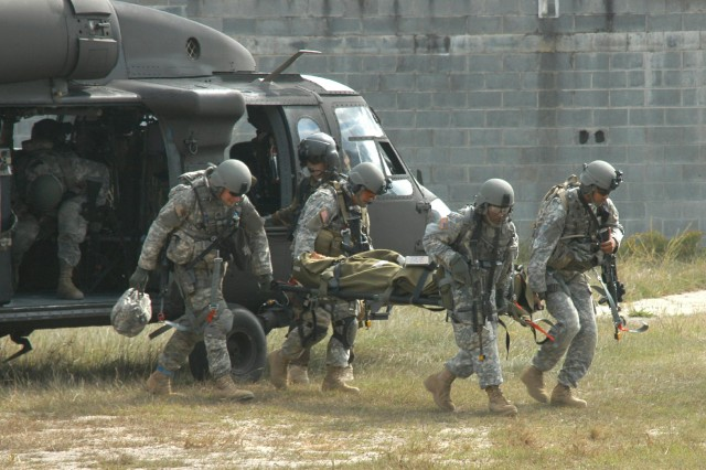 Soldiers from the 528th Sustainment Brigade unload a simulated casualty from a UH-60 Black Hawk during a MEDEVAC field-training exercise on Fort Bragg, N.C.