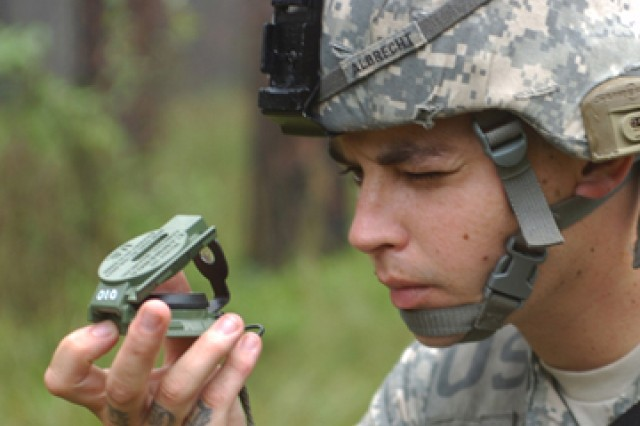 Pfc. Johannes Albrecht, 2nd Battalion, 4th Infantry Regiment, 4th Brigade Combat team, 10th Mountain Division, shoots an azimuth using a compass while negotiating a land navigation course during Expert Infantryman Badge testing on Fort Polk, La.