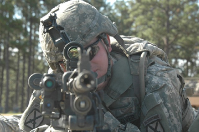 """Sgt. James Westover, gunner, Company A, 2nd Battalion, 30th Infantry, 10th Mountain Division (Light), checks his sight picture on his M240B weapon system during """"School of the Gun,"""" Oct. 2."""