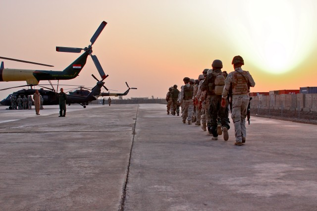 CAMP TAJI, Iraq-Under the morning sun, Iraqi Army Soldiers walk out to their aircrafts to conduct a joint air assault mission with Soldiers from 1st Battalion, 5th Cavalry Regiment, 1st Brigade Combat Team, 1st Cavalry Division, Oct. 26.