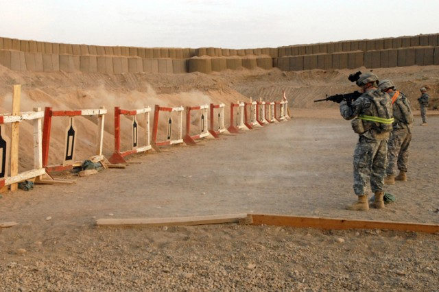 Non-commissioned officers and junior Soldiers fire their weapons during a marksmanship event that was part of both the NCO and Soldier of the Quarter competitions held on Forward Operating Base Warrior, Kirkuk, Iraq, Oct. 23. Participants were also tested on operating a radio, performing first aid, land navigation and functions testing a grenade launcher.