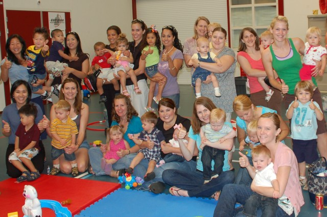 Members of USAG Schinnen's Thursday morning Play Group give the program a big thumbs up for social and emotional support.