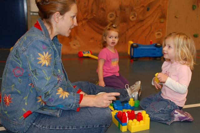 Kelley Kagele first came to Schinnen's Play Group four years ago with her older daughter and continued after HannaFleur, age 2, was born (pictured in back). Here, she chats with HannaFleur's new friend.