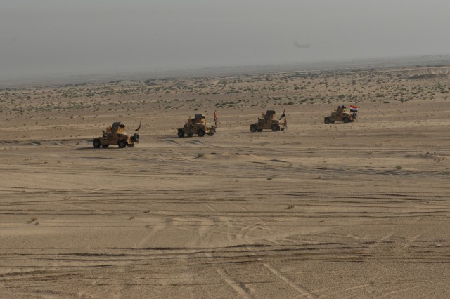 A platoon of Iraqi Soldiers travel to the first phase line to participate in tasks such as executing basic troop-leading procedures, transmitting proper contact reports and maneuvering a squad during a live-fire exercise at the Razazah Sands defensive live-fire range near Karbala, Iraq, Oct. 15.