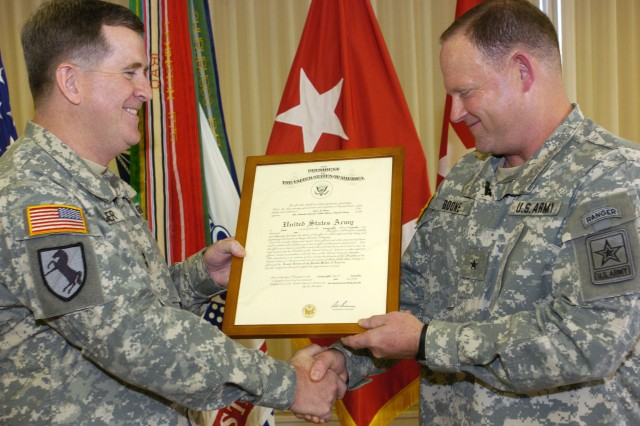 Chief of Army Public Affairs Maj. Gen. Kevin J. Bergner presents Deputy Chief of Army Public Affairs Brig. Gen. Lewis M. Boone with his promotion certificate signifying his appointment to the rank of brigadier general. Boone was promoted during a ceremony held Oct. 22, 2009, at Fort Belvoir, Va.