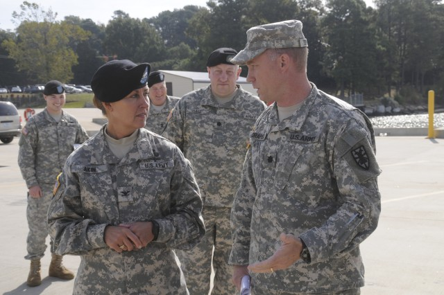 Colonel (promotable) Robin Akin (left) 3rd Expeditionary Sustainment Command, talks with Lt. Col. William Draper (right) commander, 10th Transportation Battalion, 7th Sustainment Brigade, during her visit to Fort Eustis' 3rd Port Oct. 22.  (U.S. Army photo by Sgt First Class Kelly J. Bridgwater)
