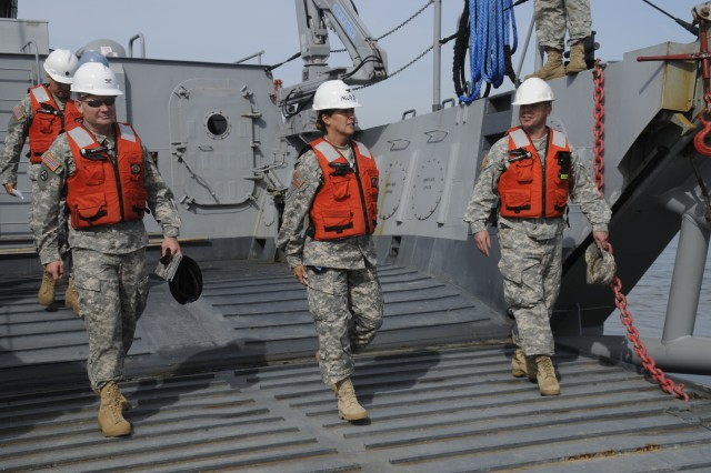 Colonel (promotable) Robin Akin (center) 3rd Expeditionary Sustainment Command, Fort Knox, Ky., and Col. Chuck Maskell, commander, 7th Sustainment Brigade (left) exit a Landing Craft Mechanized (LCM8 Modular II) vessel at Fort Eustis' Anzio Beach. Akin met with Soldiers and senior leaders of the 7th Sustainment Brigade, Fort Eustis, Va., Oct. 22.  (U.S. Army photo by Sgt First Class Kelly J. Bridgwater)