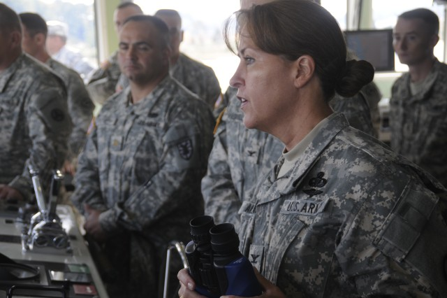 Colonel (promotable) Robin Akin observes 3rd Port boat operations while on board a Landing Craft Vessel during her visit to the 7th Sustainment Brigade, Fort Eustis, Va., the morning of Oct. 22.  (U.S. Army photo by Sgt First Class Kelly J. Bridgwater)