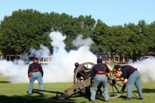 The Gun Detachment of the Fort Sill Museum fires a mountain howitzer, left, and 6-pound cannon during the Frontier Army Days Oct. 17 at the Old Post Quadrange.