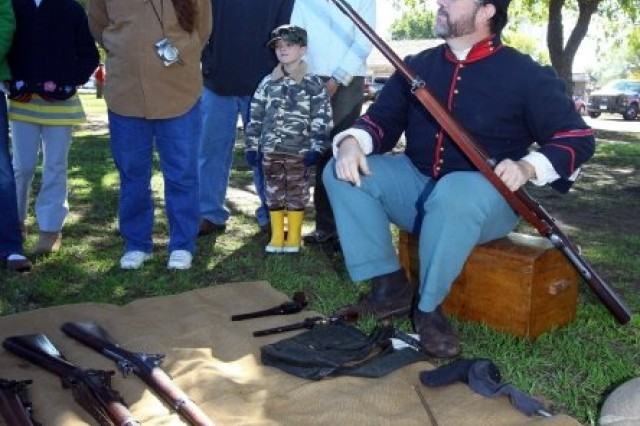 Claude Lamoreaux, a volunteer at the Fort Sill Museum, explains the various rifles, muskets and revolvers used by frontier soldiers during the Frontier Army Days. The free, seven-hour event was sponsored by the museum.