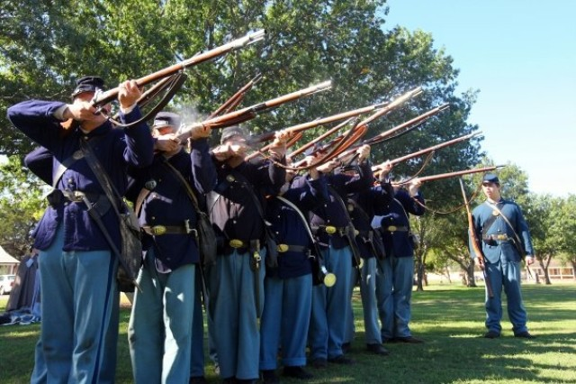 Soldiers depicting the 6th U.S. Infantry clear their muskets by firing percussion caps during a demonstration at Frontier Army Days Oct. 17 at Fort Sill's Old Post Quadrangle. They shot replica Model 1865 Springfield rifles, a .58 caliber weapon which was the standard Army issue for infantry soldiers in the 1860s. The soldiers came from the Frontier Brigade Living History Associations 10th Kansas Volunteer Infantry, 77th Pennsylvania Volunteer Infantry and the 2nd Colorado Volunteer Infantry.