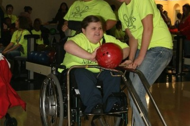 Christina Melton Martin pushes a bowling ball down the lane at the Special Olympics Bowling competition at Twin Oaks Bowling Center Oct. 16.
