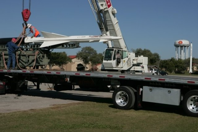 Curtis Condit, left, museum exhibit specialist, helps employees from Barnhart Crane unload an Air Defense Artillery missile at Fort Sill. The missiles, originally on display at the Fort Sill Museum, have been moved to Fort Sill as part of the BRAC move of the ADA branch from Fort Bliss to Fort Sill. Fort Sill will build a new museum to compliment the current Fort Sill Museum and Field Artillery Museum.