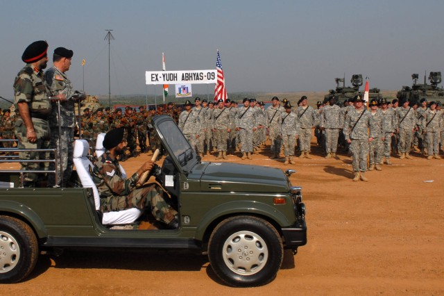 CAMP BUNDELA, India (Oct. 27, 2009)  - Indian Army Lt. Gen. A.S. Sekhon, Indian army director of general military operations, and U.S. Army Lt. Gen. Benjamin R. Mixon, commanding general, U.S. Army, Pacific, conduct a pass and review of the troops during the closing ceremony of Exercise Yudh Abyas 09, a bilateral exercise involving the Armies of India and the United States.