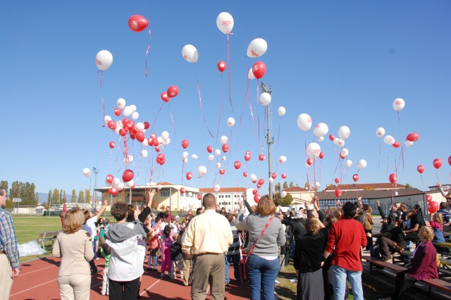Community members at USAG Vicenza, Italy, release hundreds of balloons in honor of Red Ribbon Week Oct.25 at Caserma Ederle.  The balloons contained drug-free messages in English and Italian.