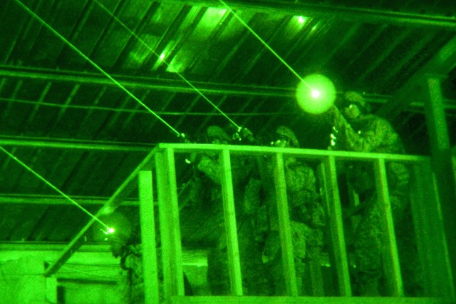 As seen through a night-vision device, U.S. Army paratroopers train using infrared lasers and night-vision optics on Camp Ramadi, Iraq, Oct. 26, 2009. The Soldiers train constantly to maintain their fighting edge while standing ready to provide assistance to Iraqi security forces.