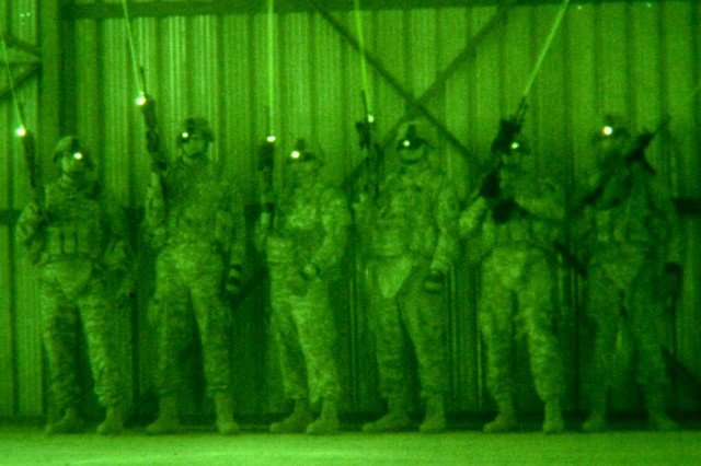 As seen through a night-vision device, U.S. Army paratroopers train using infrared lasers and night-vision optics in an urban operations setting on Camp Ramadi, Iraq, Oct. 26, 2009. The Soldiers train constantly to maintain their fighting edge while standing ready to provide assistance to Iraqi security forces.