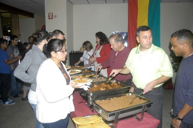 The main food line.  Servers, R to L, are Capt. Antonio Espinal, Brussels garrison Command Sgt. Maj. Anthony Cordova, USAG Brussels employees Rogelio Preciado and Yvonne McQuire, and volunteer Carine Vigil.