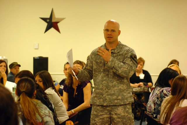 Maj. Charles Jack, 3rd Heavy Brigade Combat Team Battalion, 1st Cavalry Division's Rear Detachment commander, speaks to a group of brigade Family members about preparing their families for the readjustment with their loved ones after the redeployment during the Greywolf Family Challenge Workshop, at Fort Hood's Oveta Culp Hobby Soldier & Family Readiness Center.
