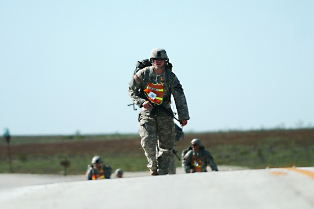 Spc. Terry Kemp, listens to his favorite tunes during the 12-mile road march portion of the Spur Ride held by 1st Squadron, 9th Cavalry Regiment, 4th BCT, 1st Cav. Div., Oct. 22 on Fort Hood.