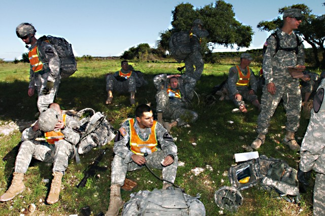 After finishing a 12-mile road march, members of 1st Squadron, 9th Cavalry Regiment, 4th BCT, 1st Cav. Div., take a break in the shade during the Spur Ride Oct. 22 on Fort Hood.
