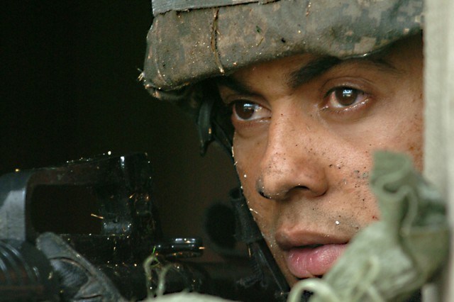 Spc. Davidson Sequeira, 1st Squadron, 9th Cavalry Regiment, 4th BCT, 1st Cav. Div., watches out for enemy activity as he allows his team inside to take a much needed break during the Spur Ride's Scout's skills portion of the event Oct. 21 on