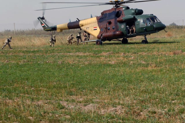 TAJI, Iraq- Iraqi Army Soldiers load into an MI-17 Hip helicopter assigned to the Iraqi Army Air Force during a combined air assault mission here, Oct. 26.