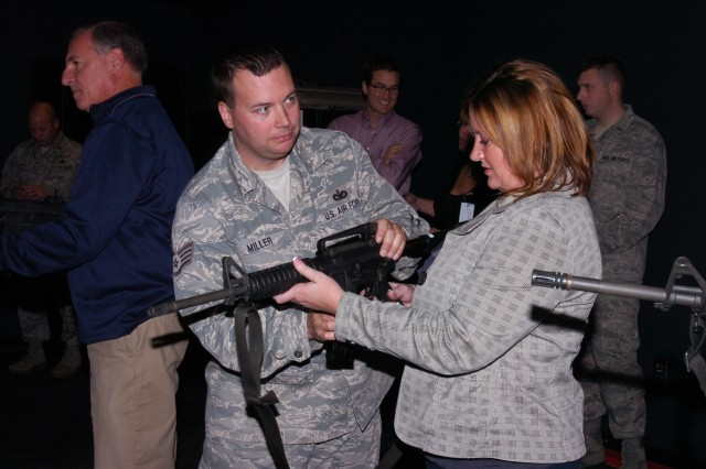 Air National Guardsman Staff Sgt. Roger Miller, an instructor with the 171st Security Forces Squadron, Coraopolis, Pa., walks a member of the local Honorary Commanders Association through the particulars of the Fire Arm Training System (FATS), a program which offers servicemembers additional weaponry training.  The HCA helps local business men and women to better understand the lives of the local men and women serving in the Army and Air Force.