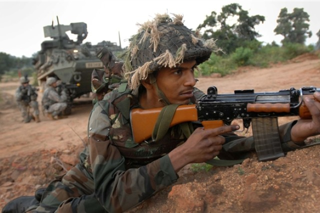 An Indian soldier helps to secure a village during a joint exercise with U.S. Soldiers at Camp Bundela, India, Oct. 24, 2009. About 250 U.S. Soldiers took 17 of their Stryker combat vehicles and paired with the Indian army's 7th Mechanized Infantry Battalion for the exercise.