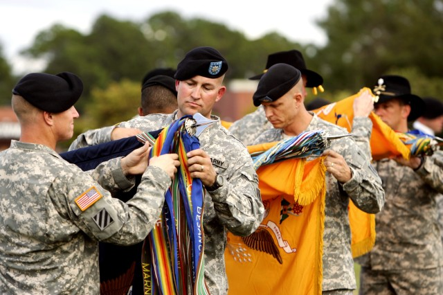 Lieutenant Colonel Daniel Cormier, 1st Battalion, 30th Infantry, and Lt. Col. Ross Coffman, 1st Battalion, 64th Armor, take part in the 2nd Heavy Brigade Combat Team's colors casing ceremony at Cottrell Field on Fort Stewart by casing their battalion Colors before deployment to Iraq for Operation Iraqi Freedom, Oct. 23.