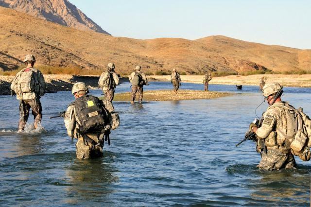 Soldiers cross a river to assist Afghan police on a humanitarian mission.