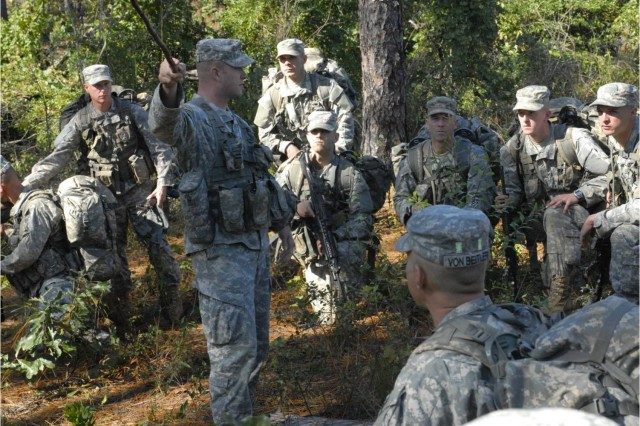SSG John Stewart, a Pre-Ranger course instructor, guides Soldiers during a recon-patrol exercise Oct. 19.