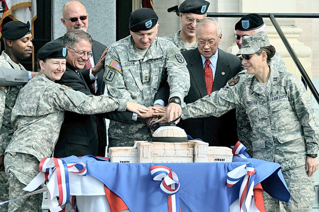 Maj. Gen. Russell Czerw (center), commander, Fort Sam Houston and Army Medical Department Center and School joins Col. Mary Garr, commander, U.S. Army Garrison, Chaplain (Capt.) Sarah Schechter and Army and civilian community leaders cutting a cake in the shape of the Gift Chapel during the centennial celebration at the chapel.