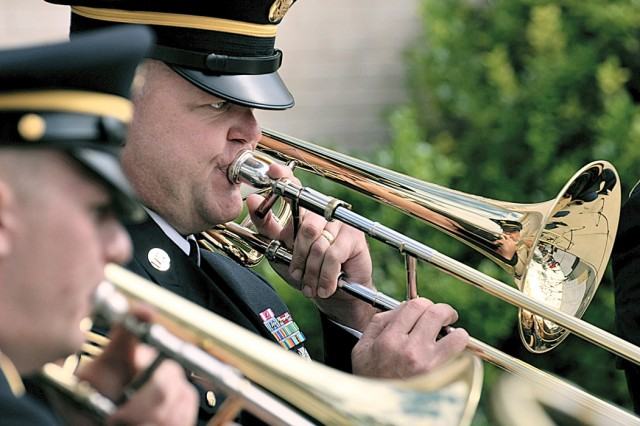 Master Sgt. Steve Baxter and Spc. Donald Pierce, members of the Strike Force Trombone Quartet, entertain the gathering at the centennial celebration.
