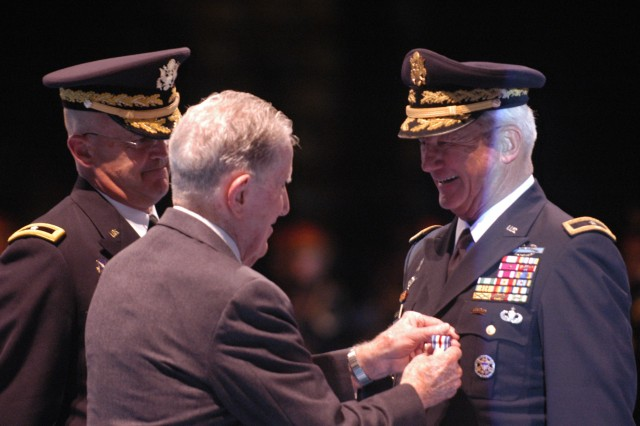 Retired Lt. Gen. John Cushman pins the Silver Star on retired Brig. Gen. John W. Nicholson on Fort Myer, Va., Oct. 28, as Brig. Gen. Karl R. Horst, commanding general, Joint Force Headquarters-National Capital Region and Military District of Washington looks on.