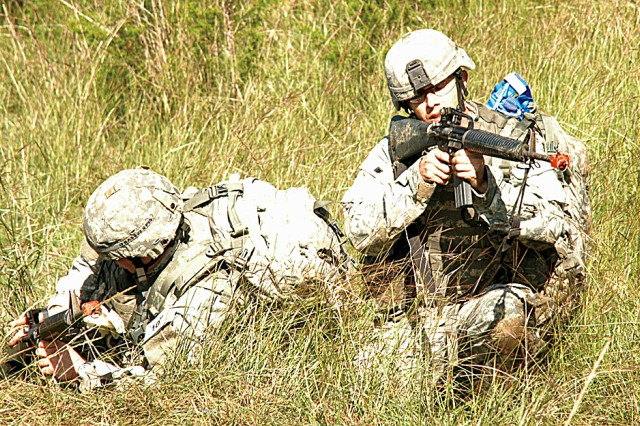 Capt. Brett S. Almond (left) and Sgt. John D. Hudgins react to enemy fire during one of the EFMC combat medical lanes. Both are from West Point, N.Y., Medical Department Activity and represented the North Atlantic Regional Medical Command.