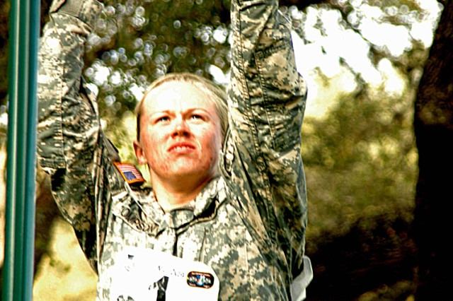 Sgt. Stephanie R. Thompson crosses the overhead ladder obstacle during the Expert Field Medical Competition. She is a healthcare sergeant in the 4th Brigade Special Troops Battalion of the 1st Cavalry Division at Fort Hood, Texas.