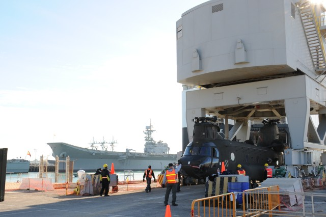 Personnel from the Theater Aviation Sustainment Manager-Europe offload a CH-47 Chinook from the back of a cargo ship at the U.S. Naval Base in Rota, Spain, Oct. 25.  TASM-E, headquartered at Coleman Barracks in Mannheim, Germany, has the mission to provide field, sustainment and limited depot-level aviation maintenance to both aircraft and aviation ground support equipment.