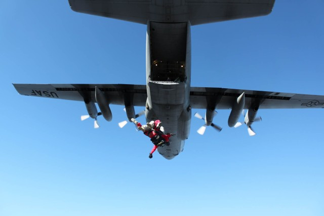Staff Sgt. David Scott with the 46th Adjutant General Battalion and Larry Compton, lead tandem instructor for Skydive Kentucky in Elizabethtown, jump out of a C-130 Hercules on Oct. 19 over Fort Knox Godman Airfield. The Fort Knox Skydiving Club and Skydive Kentucky provided free skydives to returning combat veterans as a show of appreciation for their service.
