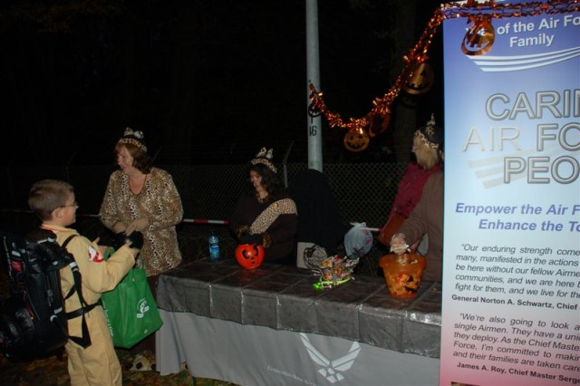 The Geilenkirchen Family Readiness Group from the NATO Air Base in Germany enjoys handing out goodies during the garrison's Trunk or Treat 2009 held Oct. 30.