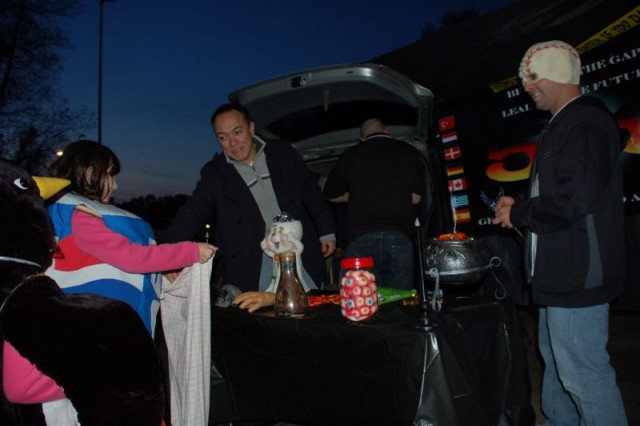 "An international atmosphere and a clear cool night welcomed ""trunk-or-treaters"" during USAG Schinnen's Trunk or Treat 2009 held Oct. 30. ""The Geilenkirchen 5 & 6 Club"" (pictures here) won the ""best trunk""."