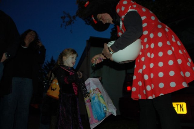 Mini-Mouse (right) rewards a ghostly costumed participant during USAG Schinnen's Trunk or Treat 2009 held Oct. 30.