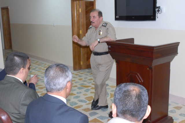 Major General Dlear Ahmed, the head police investigator at the Criminal Forensics Lab in Erbil, explains to a group of 18 judges and lawyer how his lab is using modern equipment to help solve criminal cases. This group visited the lab Oct. 27 to learn more about its capabilities.
