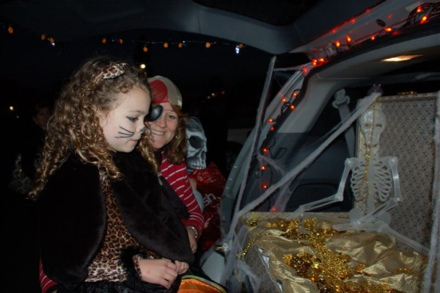 The back of a truck serves as a secret pirates treasure chest where goblins, ghouls and kitty cats search for treats during the garrisonAca,!a,,cs Trunk or Treat 2009 held Oct. 30.