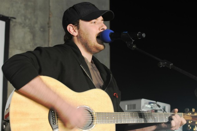 Country musician Chris Young performs one of his new hits during the Stars for Stripes tour Oct. 29 at Joint Base Balad, Iraq. Young is one of the artists performing a month-long tour at bases and hospitals throughout Germany and Iraq.