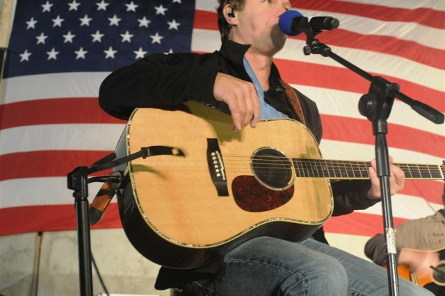 Country musician Craig Morgan performs one of his hit singles during the Stars for Stripes tour Oct. 29 at Joint Base Balad, Iraq. Morgan is one of the artists performing a month long tour at bases and hospitals throughout Germany and Iraq.